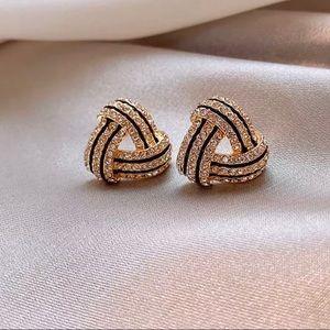 Gold tone geometric triangle earrings